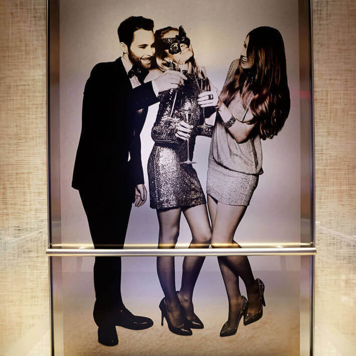 Image of People at a Party Printed on Metal Paneling inside an elevator in New York C.ity