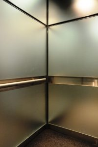 A good example of Astoria Metal Paneling inside an elevator